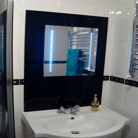 Black acrylic mirror surround