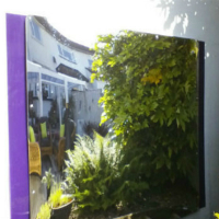 acrylic mirror throws light in garden