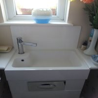 white acrylic protects the wall behind sink